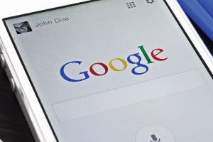 Google Search Algorithm changed for Mobile Searching - Mobile phone with Google Search display